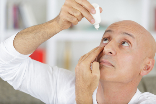 Man Applying Eye Drops