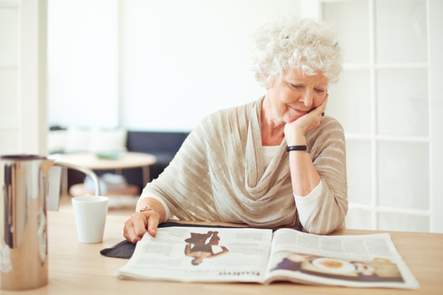 Middle-Aged Woman Reading and Smiling