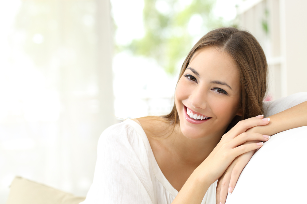Young woman smiling and relaxing after LASIK