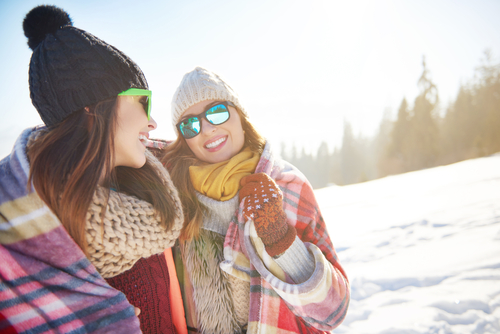 Young Women Having Fun in Snow