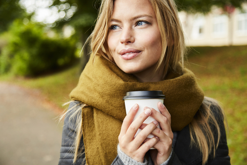 Woman in Winter Clothing Holding Coffee Cup