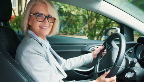 Elderly woman driving with eyeglasses before Cataract Surgery