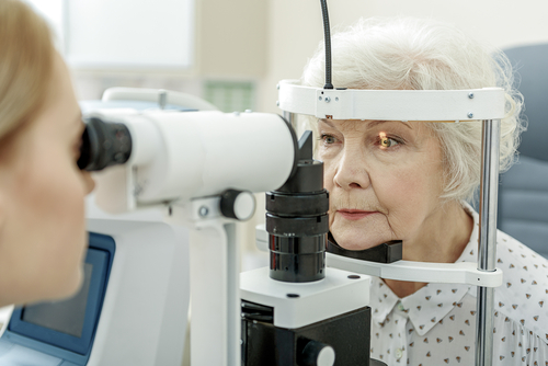 Elderly woman being tested for Glaucoma Symptoms