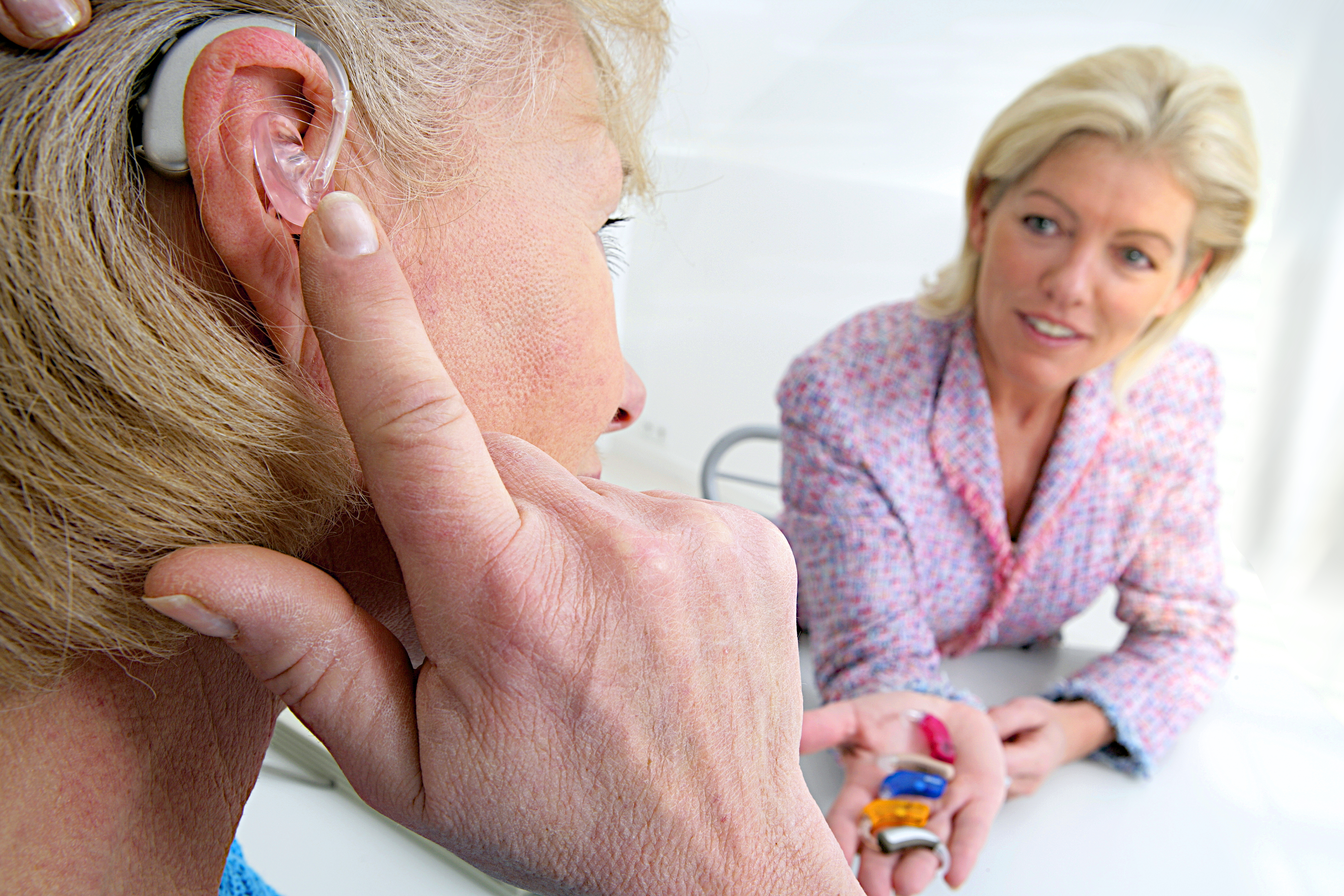 Woman trying on hearing aid
