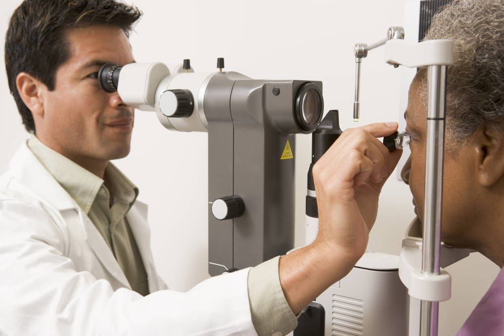 An ophthalmologist performing a comprehensive eye exam.