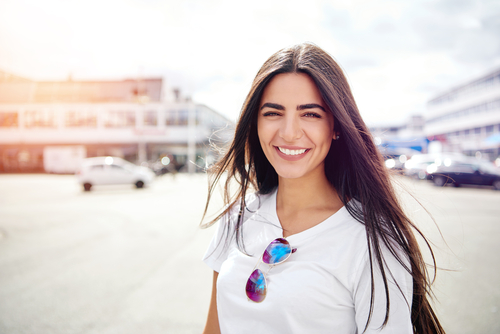 Girl with brunette hair smiling at camera