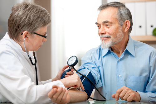 Man receiving blood pressure test