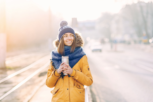 woman holding coffee in winter storm