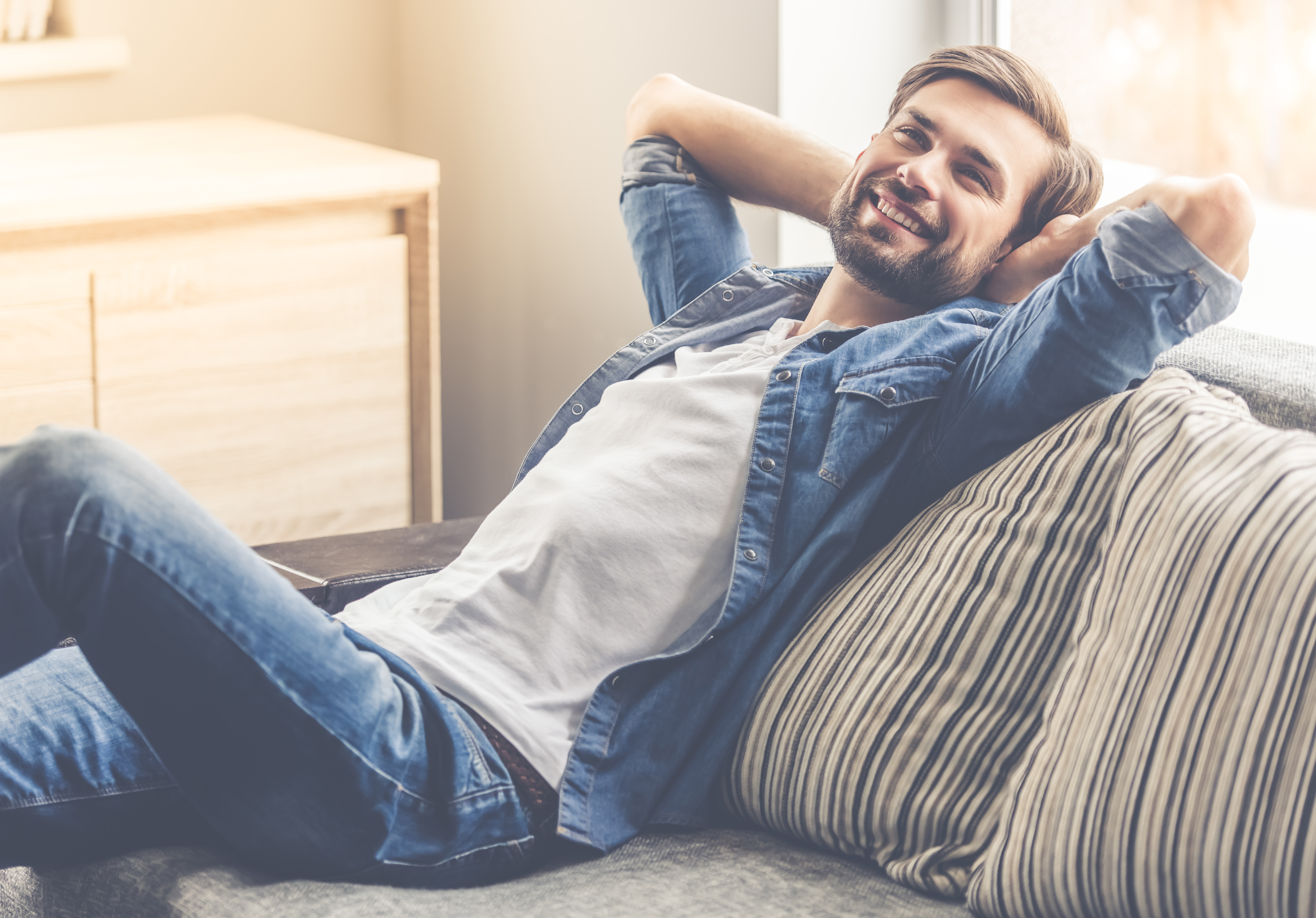 Man laying back and smiling